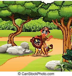 Zookeeper man with a lion walking around the jungle